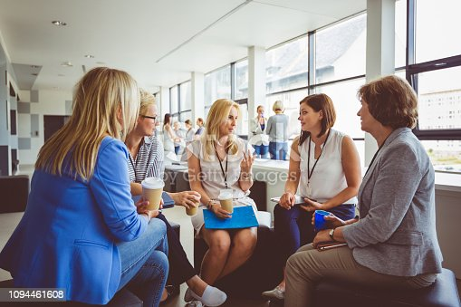 1055095320 istock photo Group of women talking during training session 1094461608