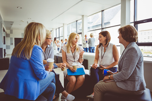 Group Of Women Talking During Training Session Stock Photo - Download Image Now