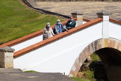 Group of women travelling. The famous historic Bridge of Boyaca in Colombia. The Colombian independence Battle of Boyaca took place here on August 7, 1819.