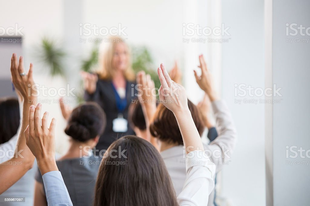 Group of women voting during seminar stock photo