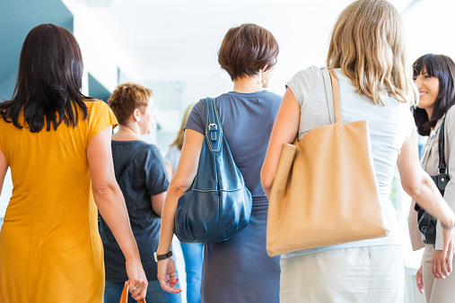 Group Of Women Walking The Hall Back View Stock Photo - Download Image Now
