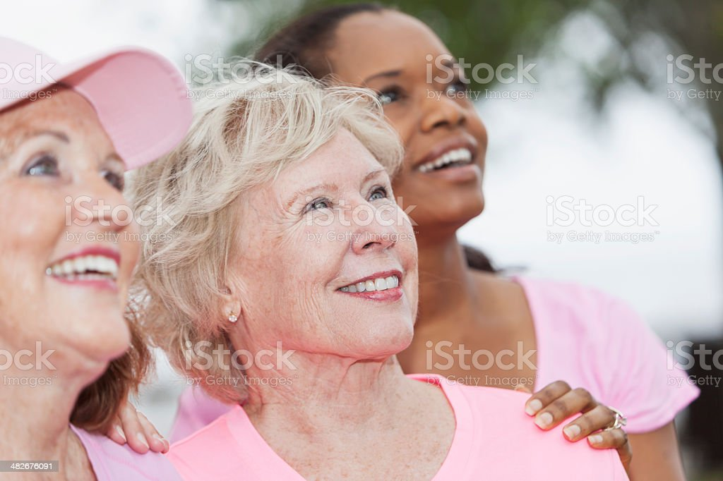 Group of women wearing pink royalty-free stock photo