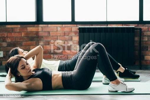 Fitness training for women, healthy lifestyle. Group of females working out at the gym.