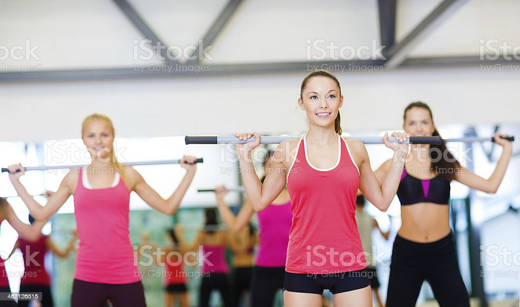 Group of women working out with barbells stock photo