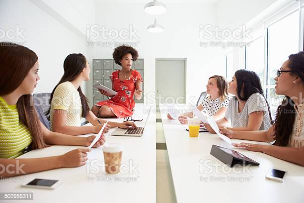 Group Of Women Working Together In Design Studio Stock Photo - Download Image Now