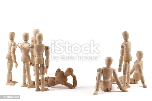 941792734istockphoto Group of wooden  mannequin looking to something - add your own text 944566668