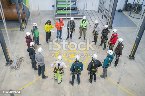 Group of workers engaged in meeting