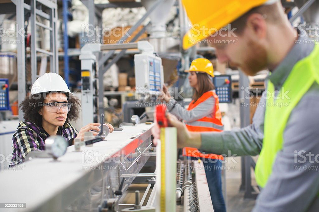 group of workers in the factory on the job stock photo - download image now