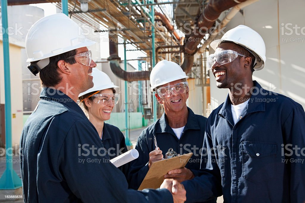 Group of workers meeting at manufacturing plant stock photo