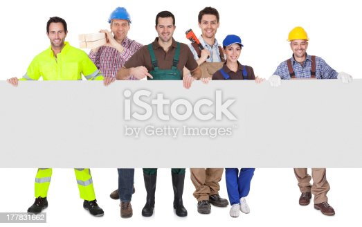 istock Group of workers presenting empty banner 177831662