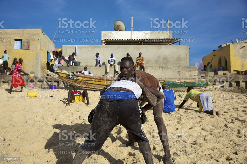 Group of wrestlers training on the beach in Senegal royalty-free stock photo