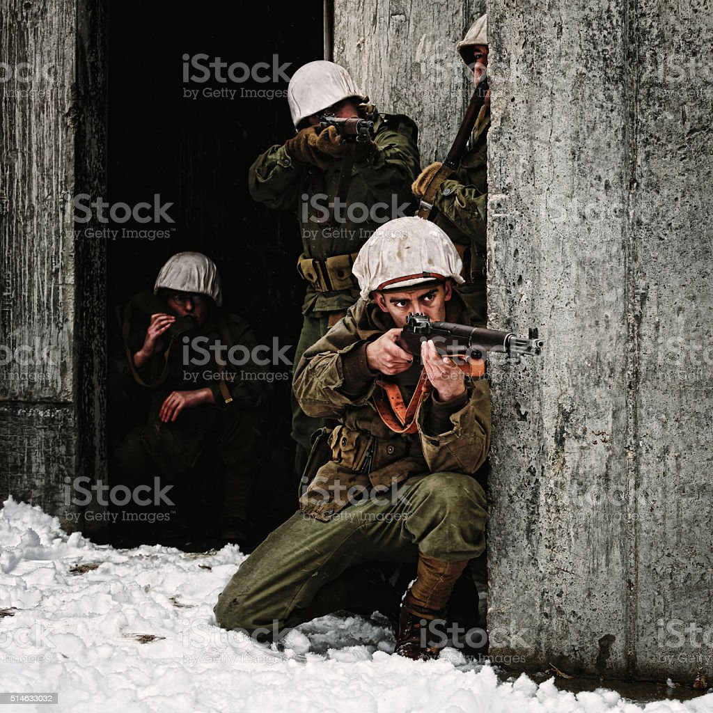 Group of WWII Winter Soldiers Taking Aim stock photo
