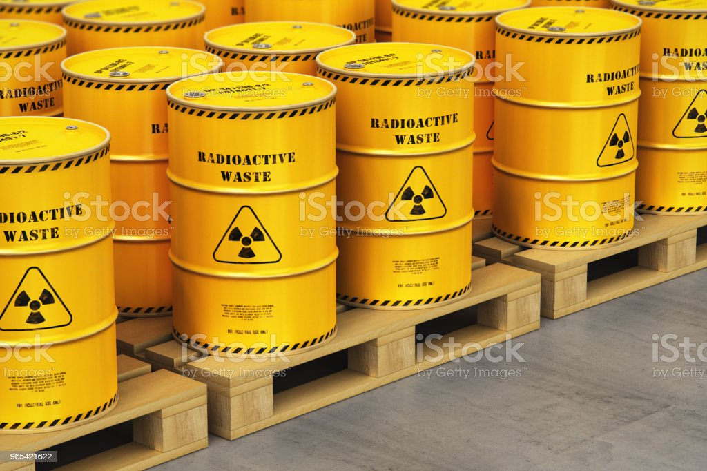 Group of yellow drums with radioactive waste on shipping pallets in warehouse zbiór zdjęć royalty-free