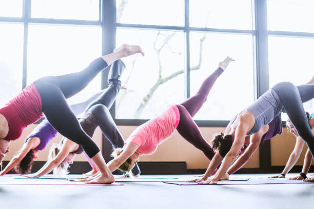 Group of yoga students in studio stock photo