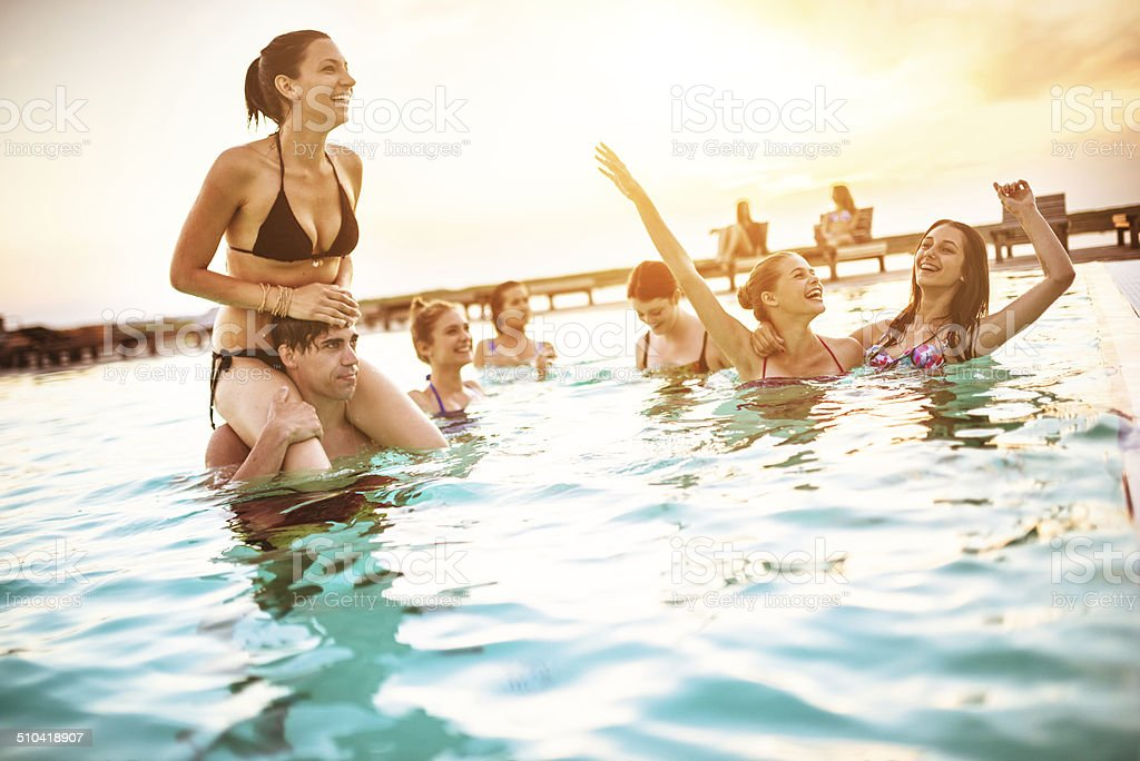 group of young adult girl having fun on swimming pool stock photo