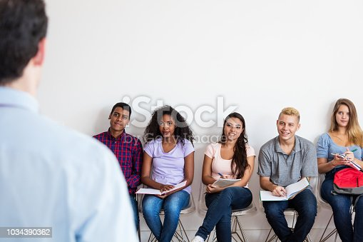 istock Group of young adult student listening to teacher 1034390362