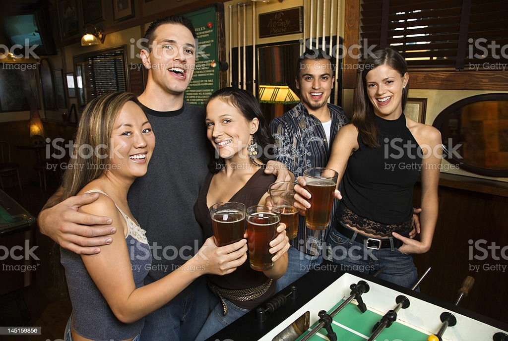 Group of young adults at bar. royalty-free stock photo