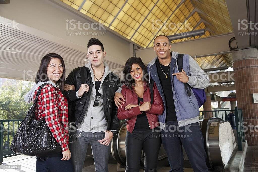 Group of young adults at train station royalty-free stock photo