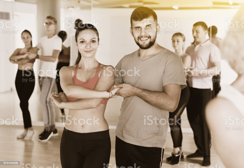 Group of  young adults dancing salsa in club stock photo