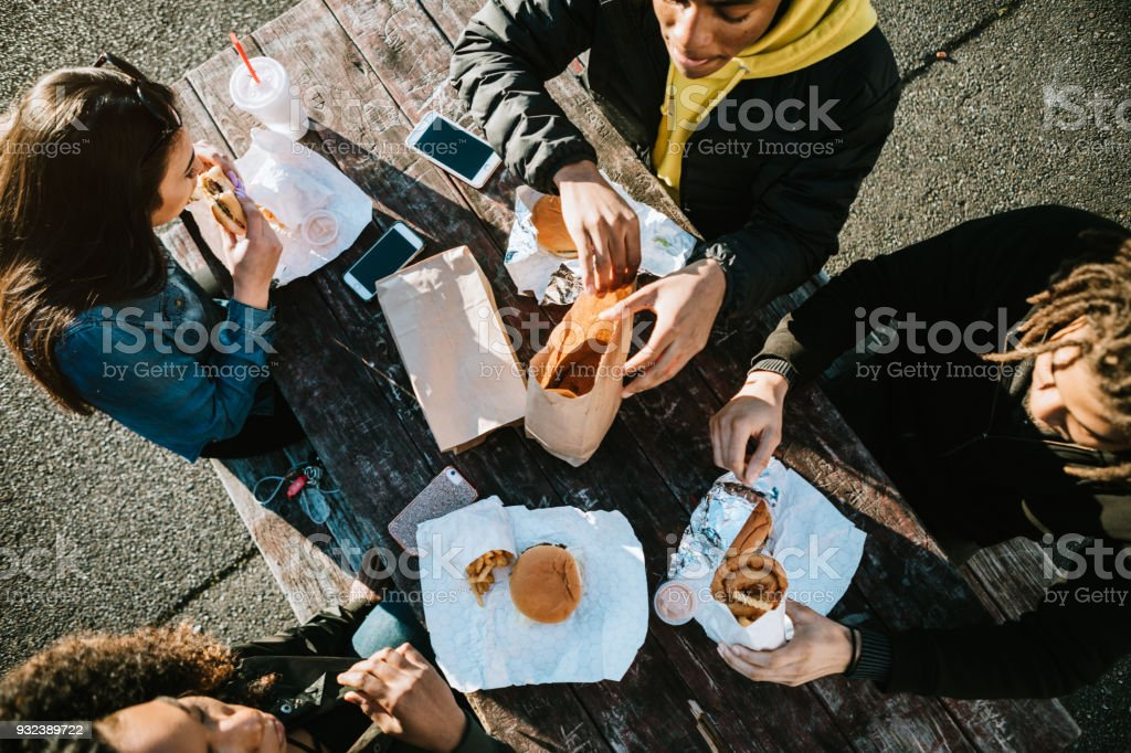 Group of Young Adults Eating Fast Food stock photo