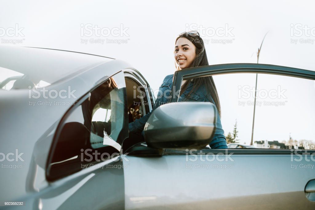 Group of Young Adults Having Fun Riding in Car stock photo