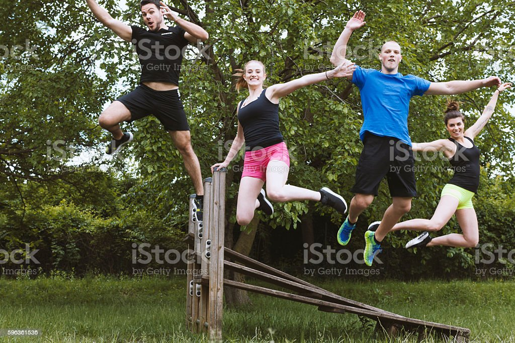 Group of Young Adults in a Dynamic Jump Portrait royalty-free stock photo