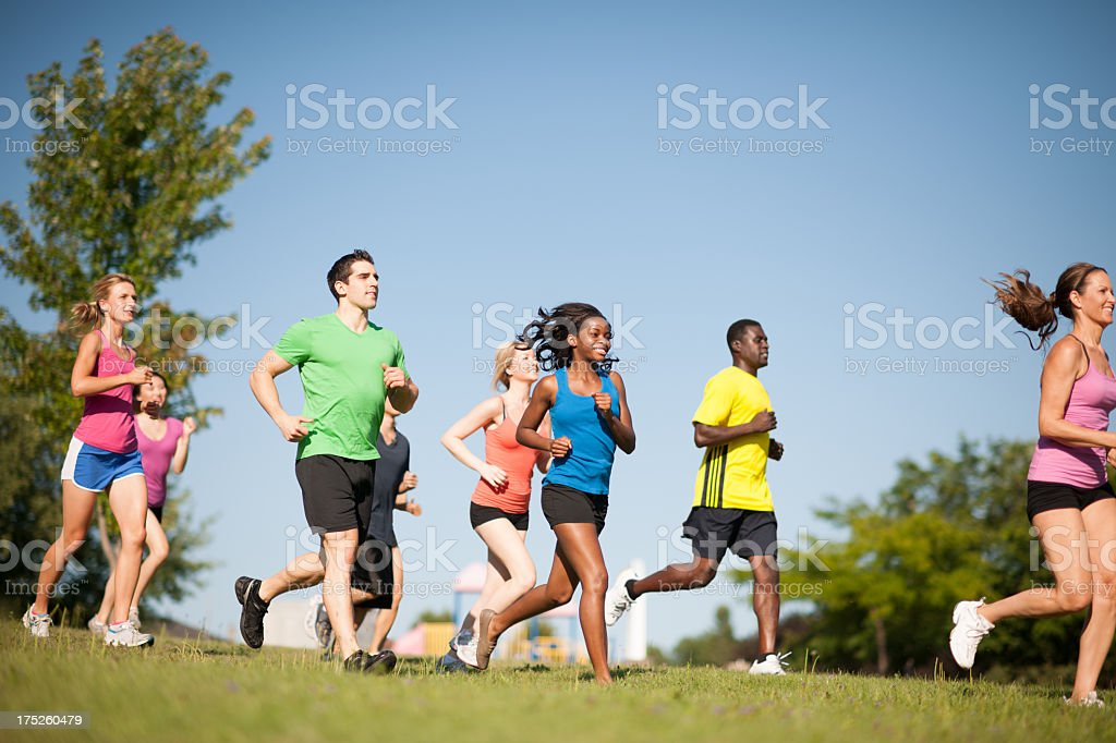 Group of young adults jogging stock photo