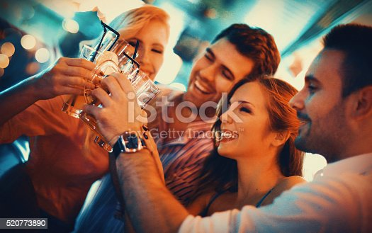 istock Group of young adults on a night out. 520773890