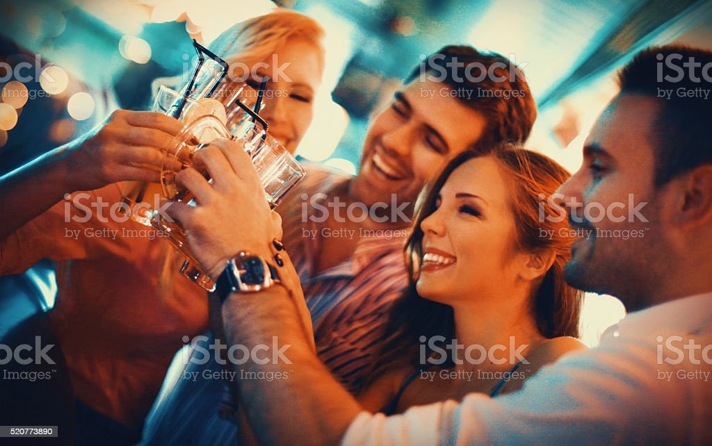 Group of young adults on a night out. stock photo