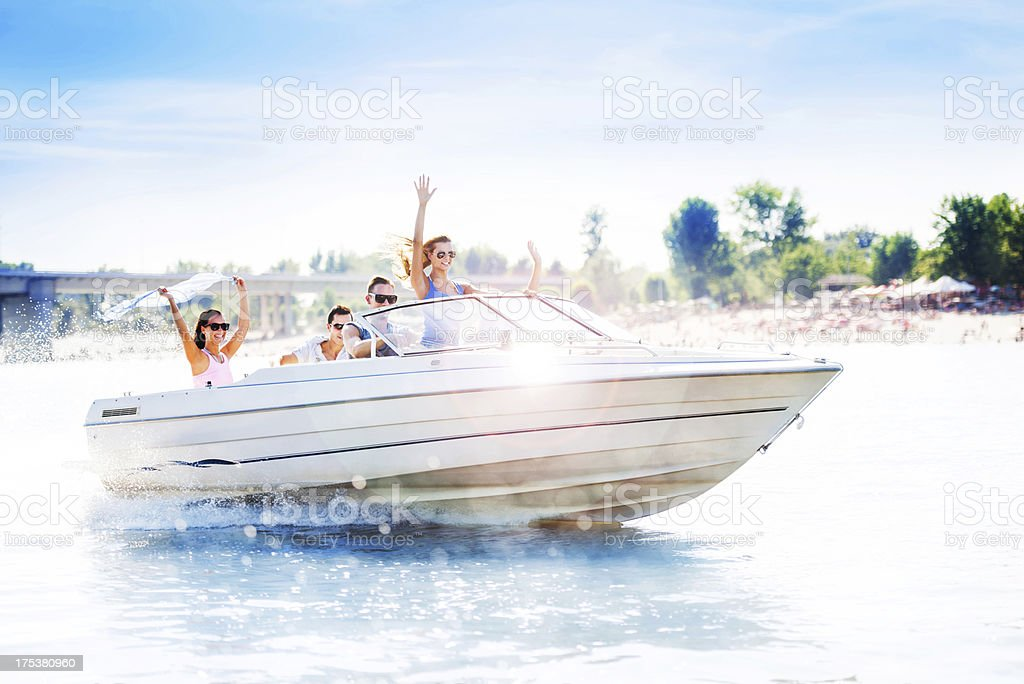 Group of young adults on a speedboat stock photo