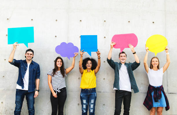 Group of young adults outdoors holding empty placard copyspace thought bubbles Group of young adults outdoors holding empty placard copyspace thought bubbles generation z stock pictures, royalty-free photos & images