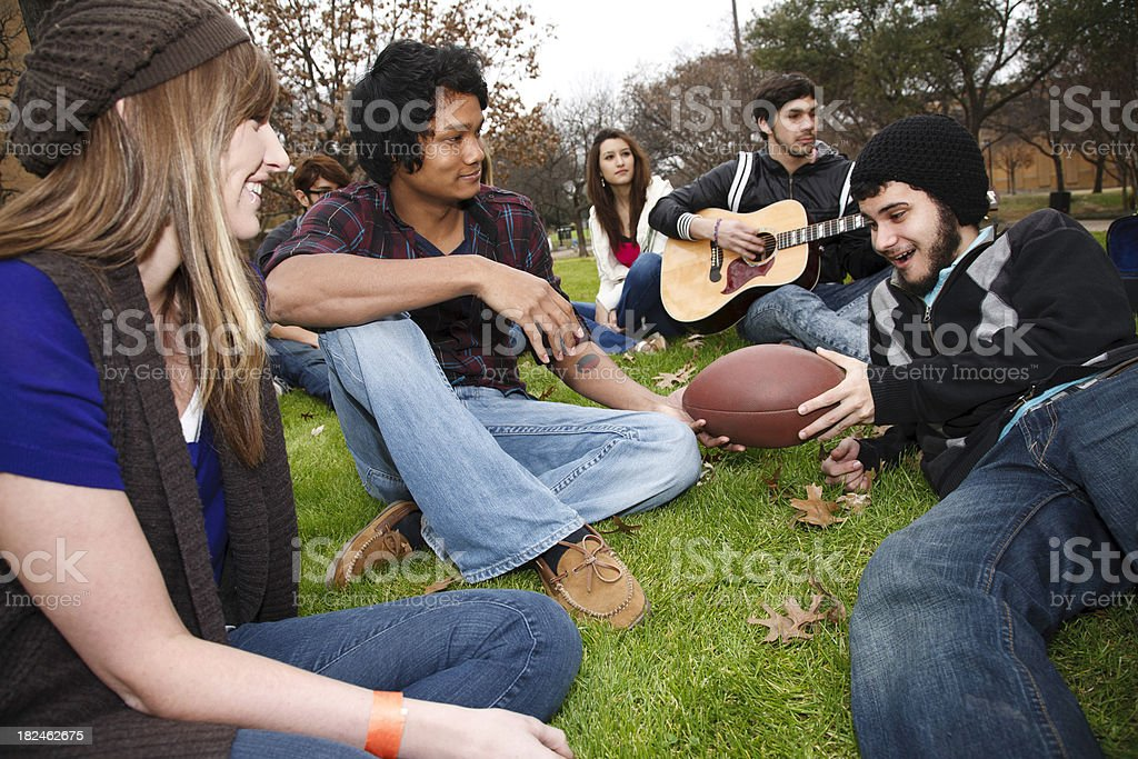 Group of Young Adults Outside on the Grass at School royalty-free stock photo