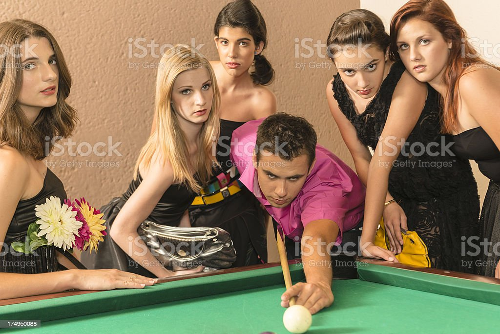 Group of young adults playing pool royalty-free stock photo