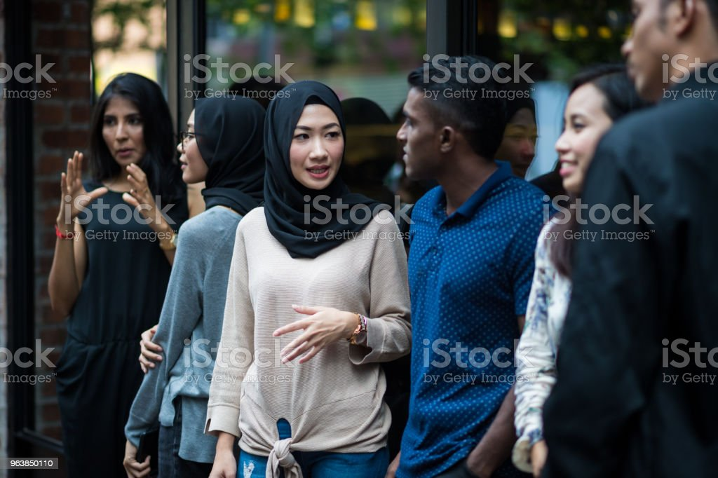 Group of young adults socializing - Royalty-free 20-29 Years Stock Photo