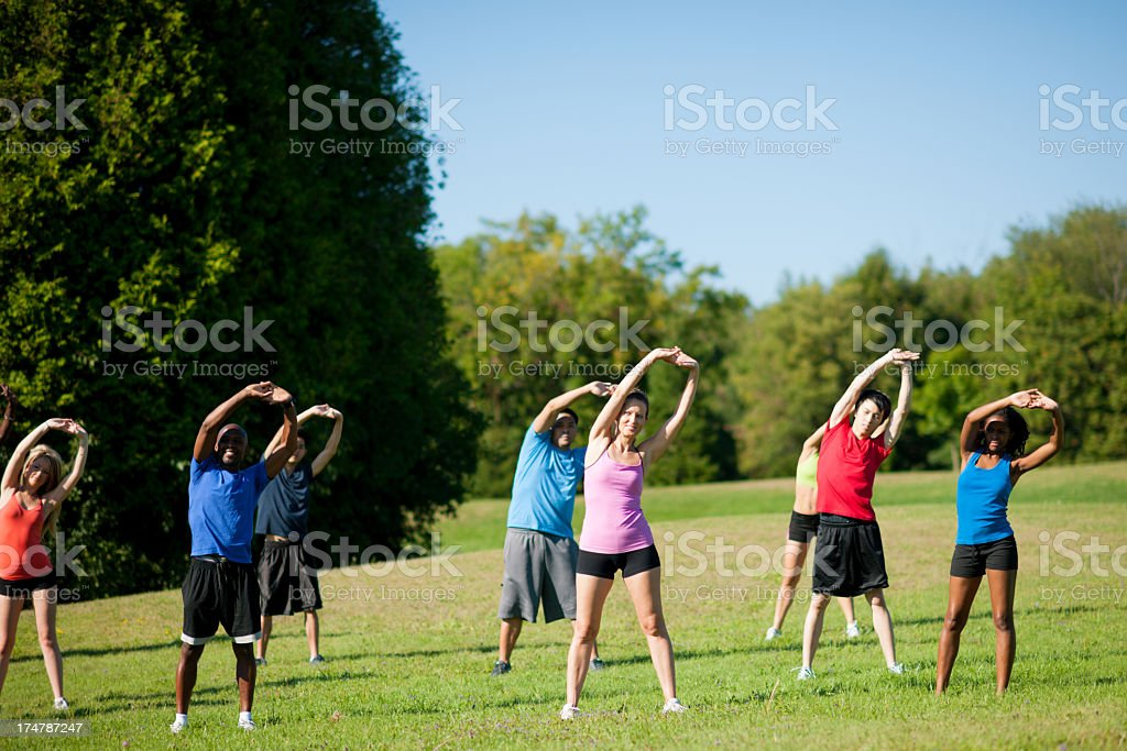 Group of young adults stretching. stock photo