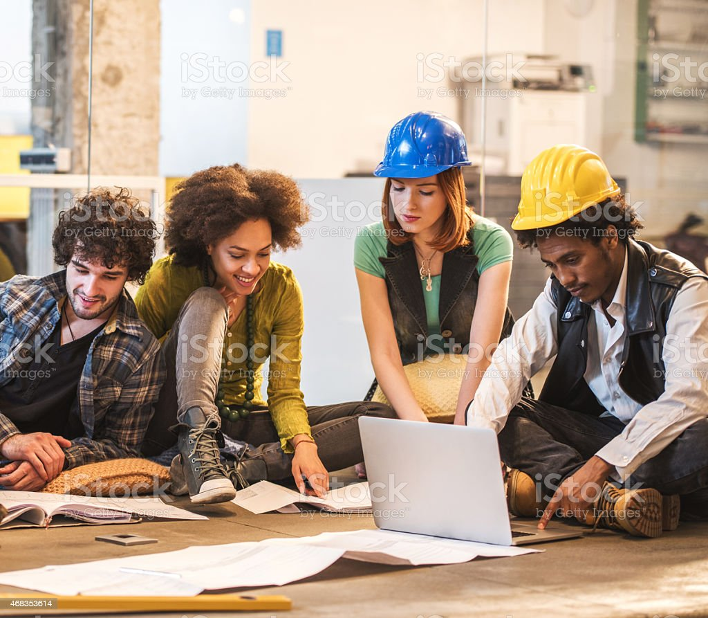 Group of young architechts working on a new plans. royalty-free stock photo
