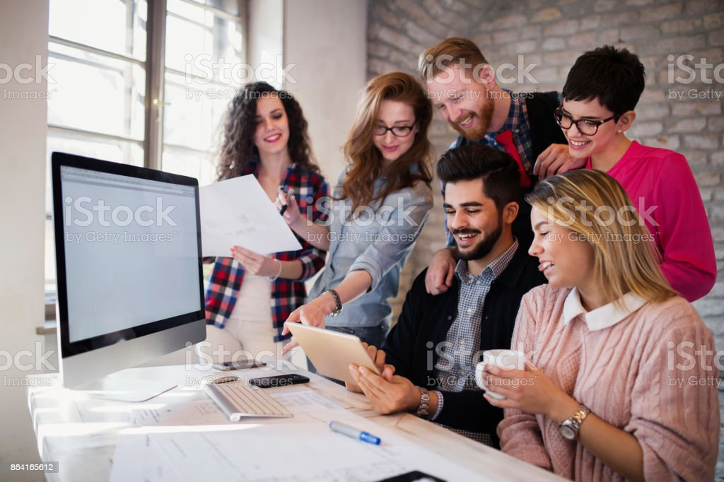 Group of young architects using digital tablet royalty-free stock photo