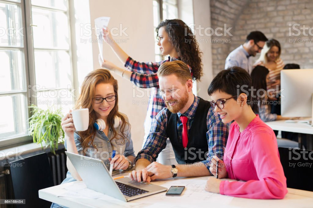Group of young architects working on computer royalty-free stock photo