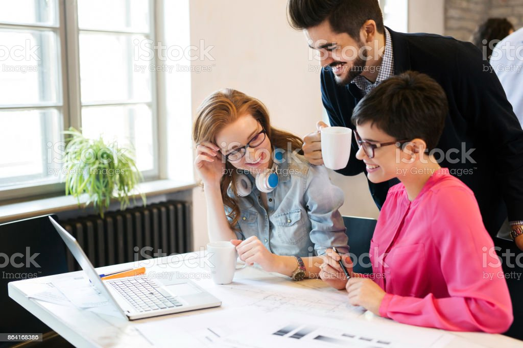 Group of young architects working on laptop royalty-free stock photo