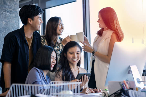 Group Of Young Asian Business People Happily Coworking Together In The Office – Foto