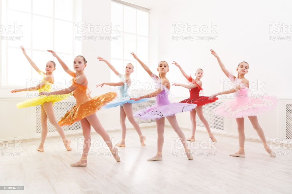 Group of young ballet dance students performing stock photo