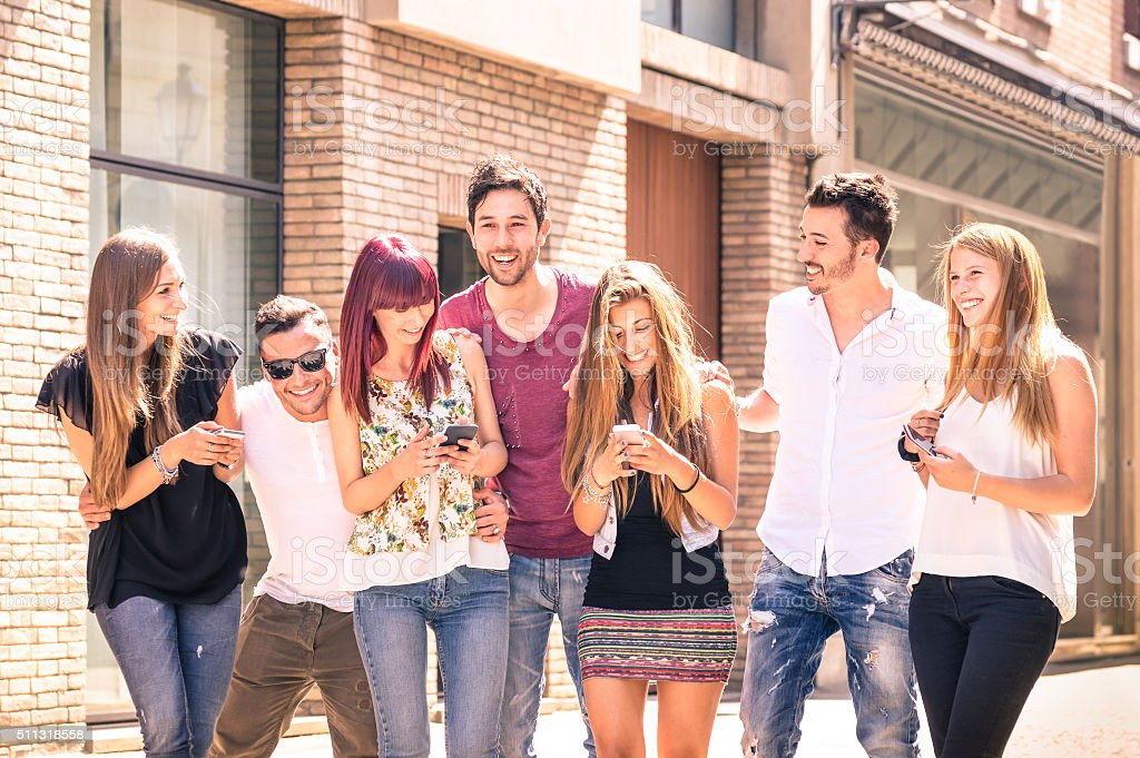 Group of young best friends having fun with mobile phone stock photo