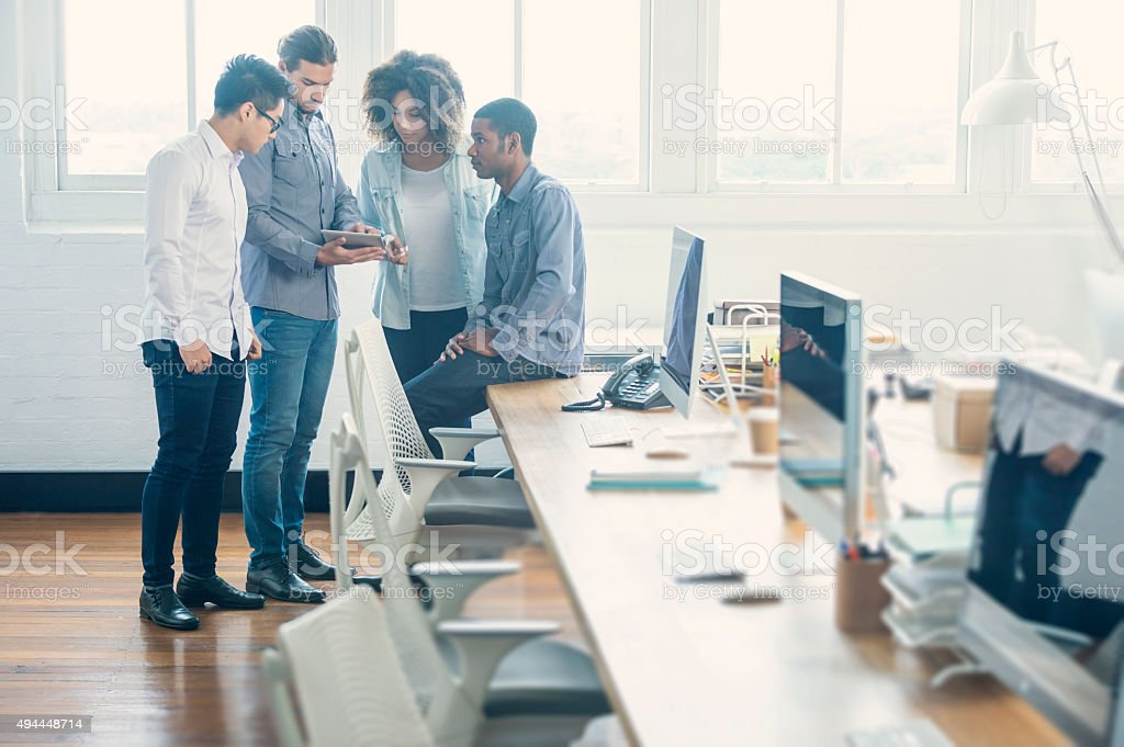 Group of young business people with technology. stock photo