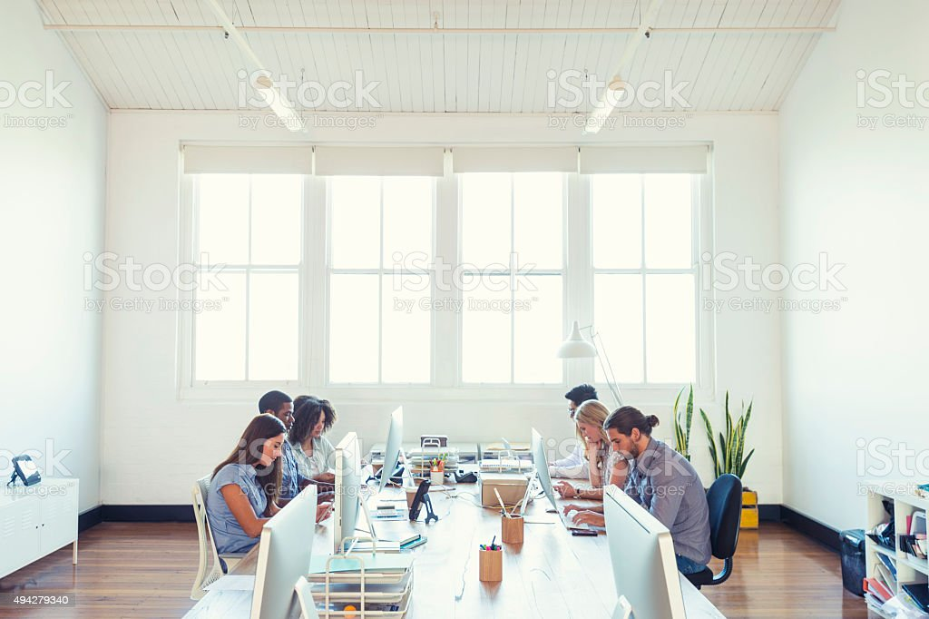Group of young business people working. stock photo