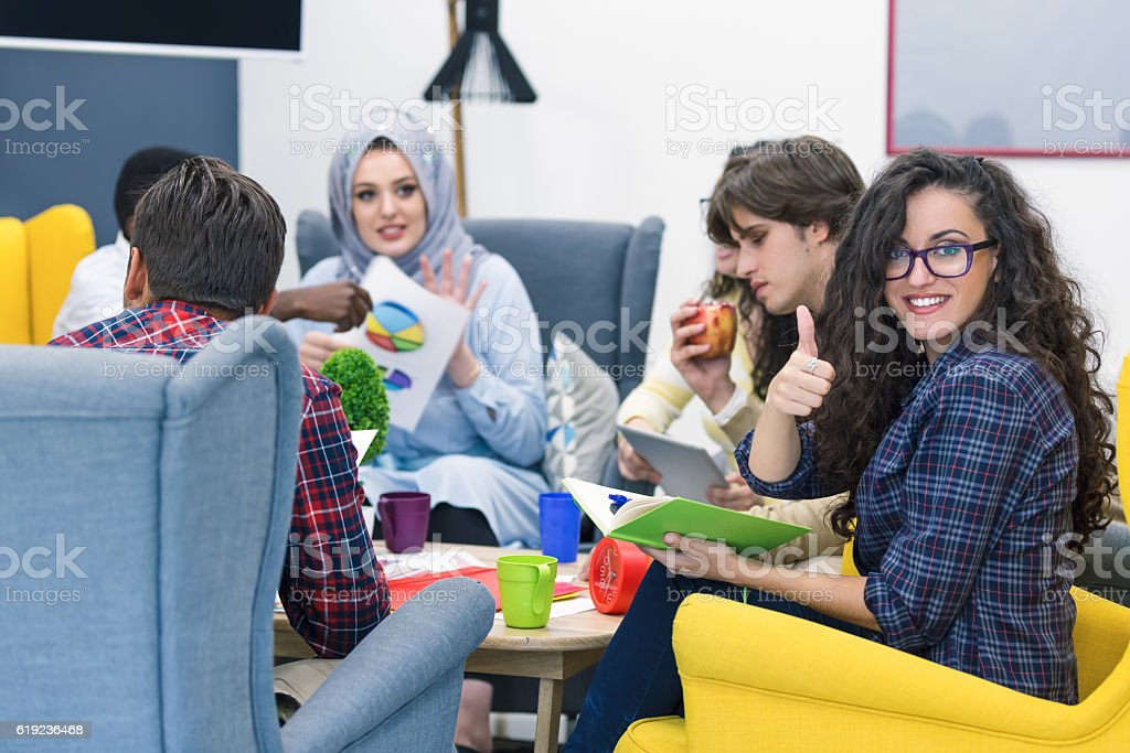 Group of young business professionals having a meeting. stock photo