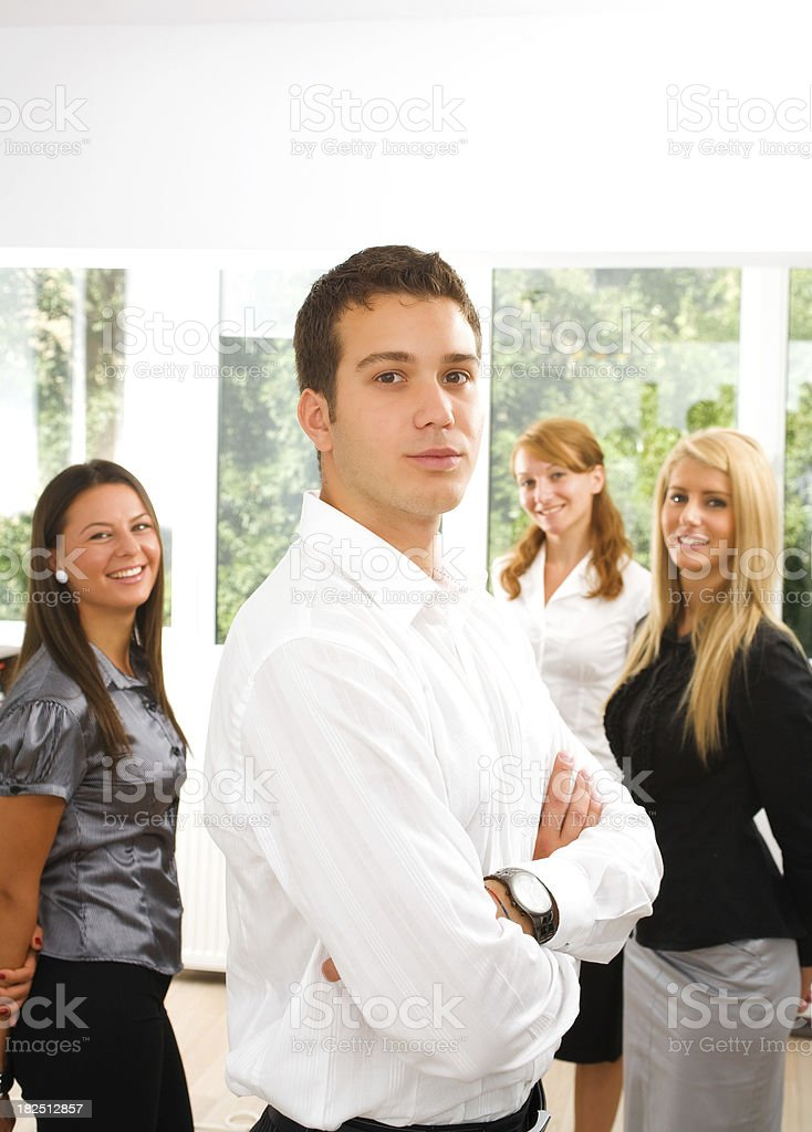Group of young businesspeople in the office (male front) stock photo