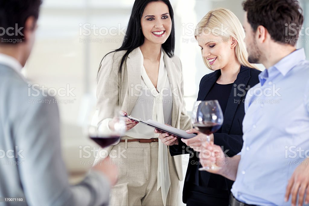 Group of young businesspeople toasting and celebrating in the restaurant royalty-free stock photo