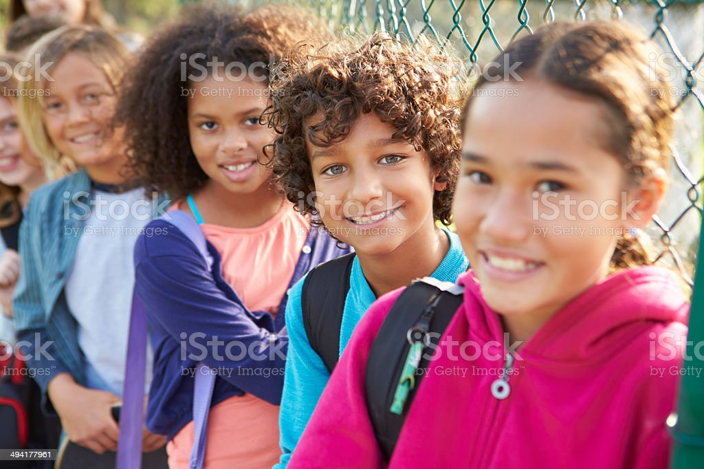 Group Of Young Children Hanging Out In Playground stock photo