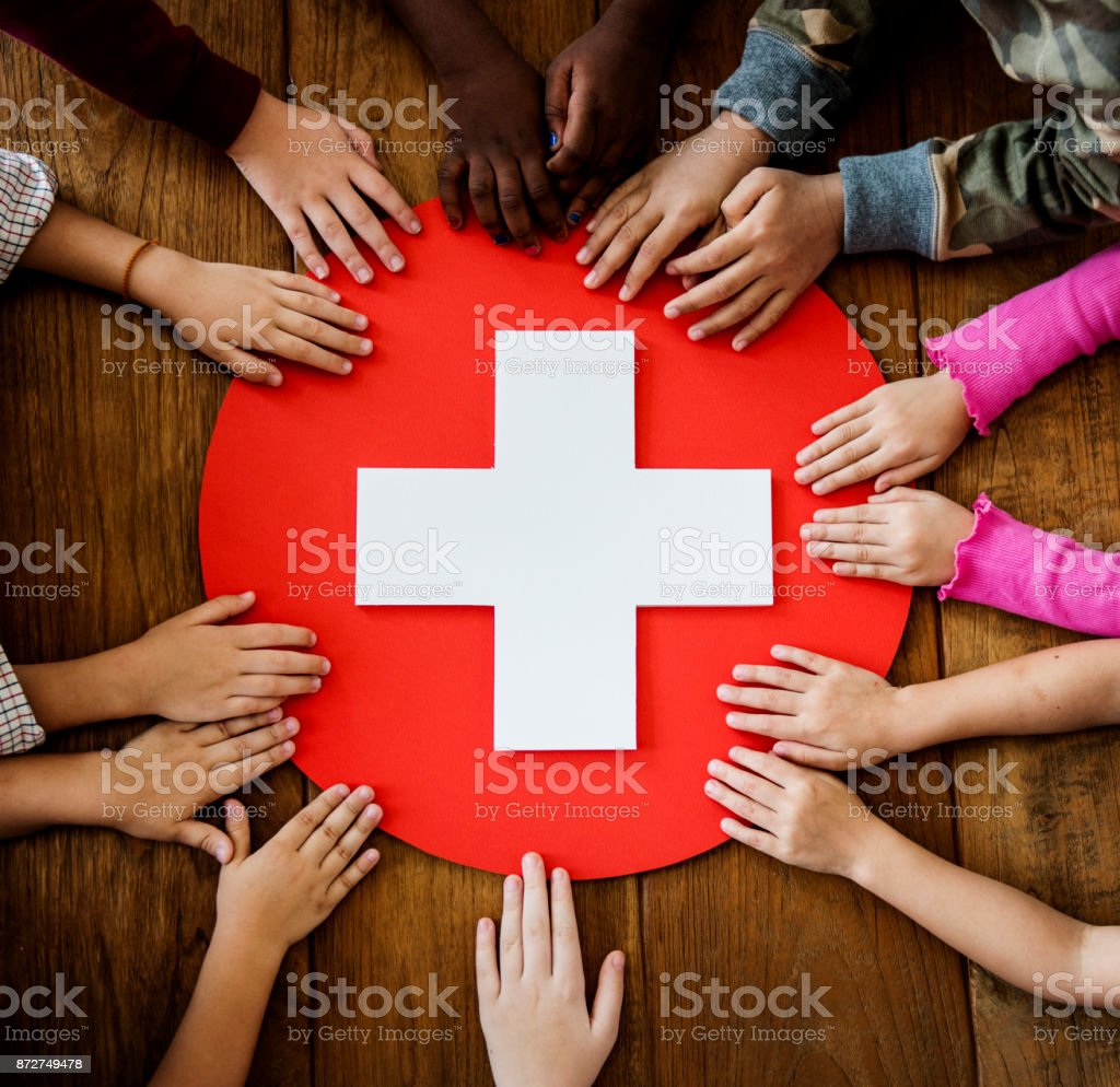 A group of young children learning about first aid stock photo