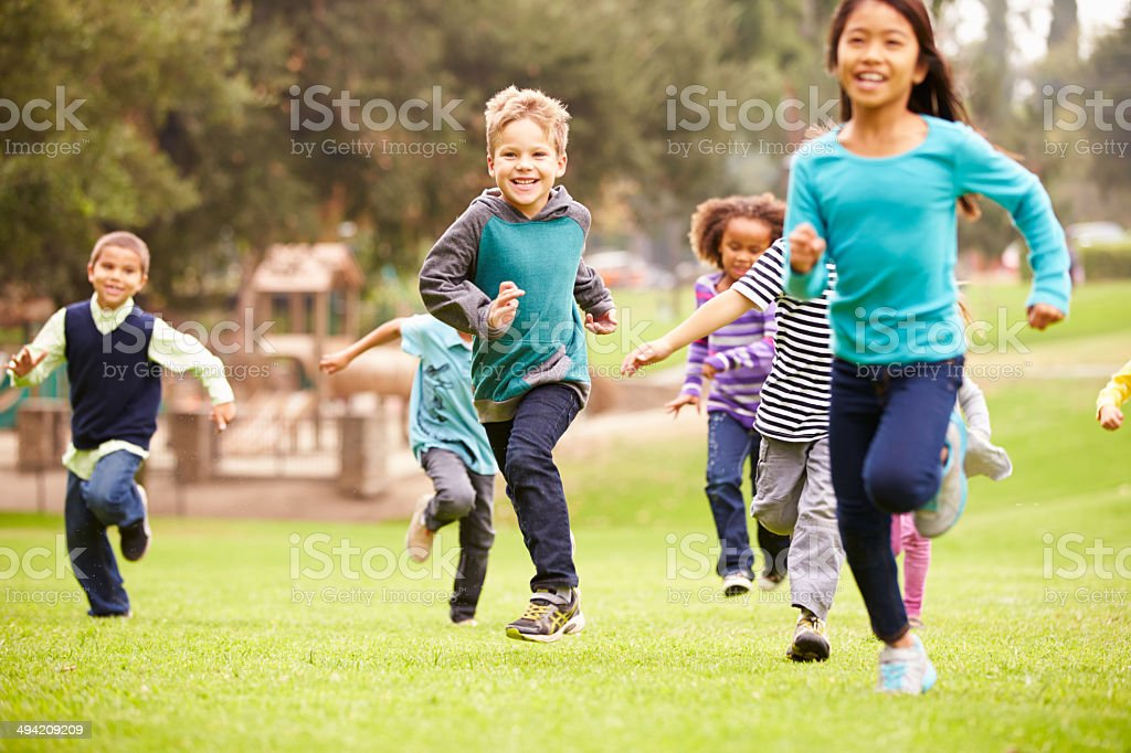 Group Of Young Children Running Towards Camera In Park royalty-free stock photo